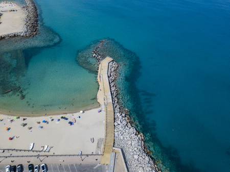 Aerial View of Pizzo Calabro, Calabria, Italy. Houses on rock, harbor and pier with moored boats