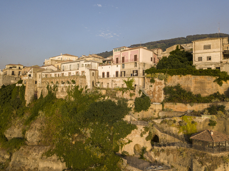 Aerial view of Pizzo Calabro at sunset, Calabria, Italy. Houses on the rock seen from the sea 版權商用圖片