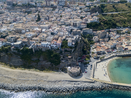 nuances: Aerial view of Pizzo Calabro, pier, castle, Calabria, tourism Italy. Panoramic view of the small town of Pizzo Calabro by the sea. Houses on the rock. On the cliff stands the Aragonese castle