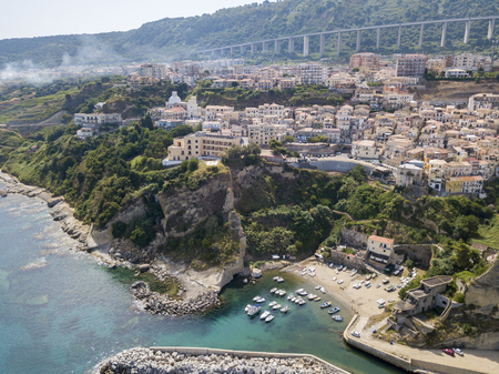 Aerial View of Pizzo Calabro, Calabria, Italy. Houses on rock, harbor and pier with moored boats.