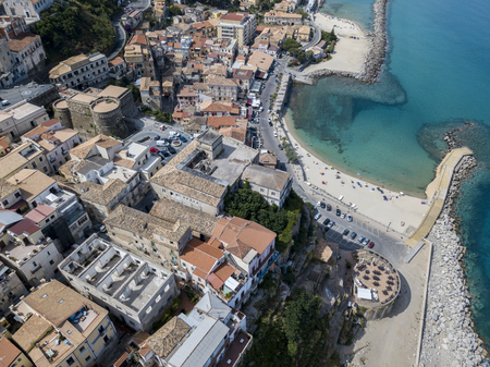 Aerial view of Pizzo Calabro, pier, castle, Calabria, tourism Italy. Panoramic view of the small town of Pizzo Calabro by the sea. Houses on the rock. On the cliff stands the Aragonese castle