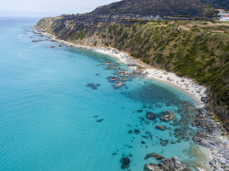 stone lion: Paradise of the sub, beach with promontory overlooking the sea. Zambrone, Calabria, Italy. Diving relaxation and summer vacations. Aerial view Stock Photo