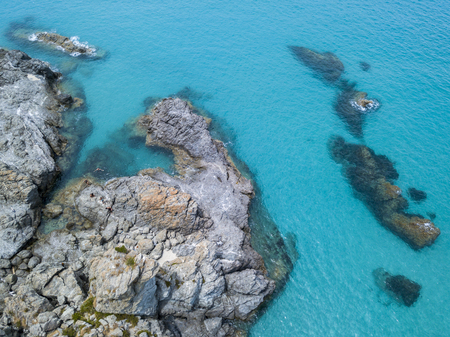 nuances: Aerial view of the rocks on the sea. Overview of the seabed seen from above, transparent water
