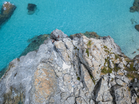 nuances: Aerial view of the rocks on the sea. Overview of seabed seen from above, transparent water.