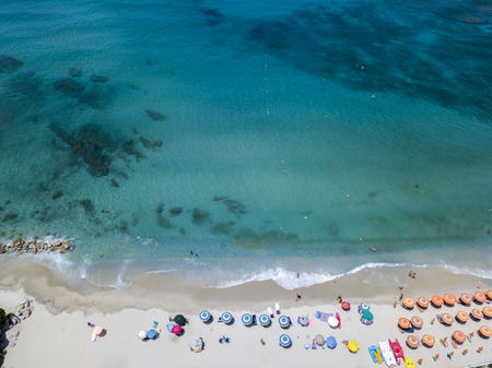 Aerial view of a beach with canoes, boats and umbrellas. Ricadi, Capo Vaticano. Calabria, Italy Stock Photo
