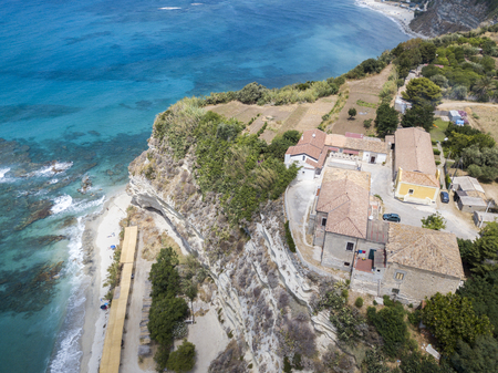 nuances: Overview of Ricadi Beach, Tower Marino, Vatican City, promontory aerial view, cliffs and sand. Summer vacations in Calabria, Italy