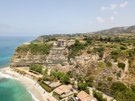 Overview of Ricadi Beach, Tower Marino, Vatican City, promontory aerial view, cliffs and sand. Summer vacations in Calabria, Italy