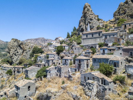 Aerial view of the village of Pentedattilo, church and ruins of the abandoned village, Greek colony on Mount Calvario, whose form recalls the five fingers, the name of the village derives from the Greek Stock Photo