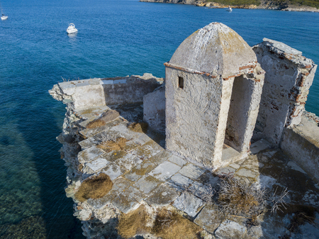 Aerial view of the Genovese Tower, Tour Genoise, details of the tower, Cap Corse Peninsula, Corsica. France. Coastline. France. Built as a defensive tower under the reign of the Republic of Genoa Stock Photo