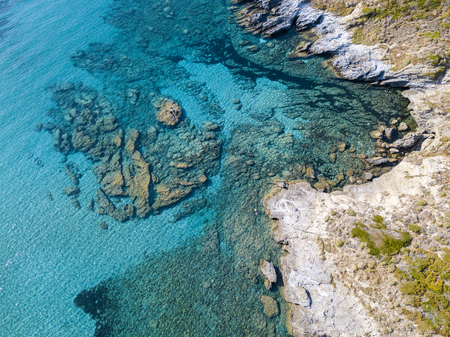 Aerial view of rocks on the sea. Overview of seabed seen from above, transparent water. Seaweed designed by algae Фото со стока