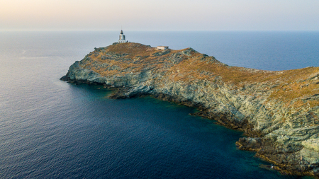 Aerial view of the Lighthouse and Tower on the island of Giraglia, the northernmost point of the Cap Corse peninsula. Corsica France Stock Photo