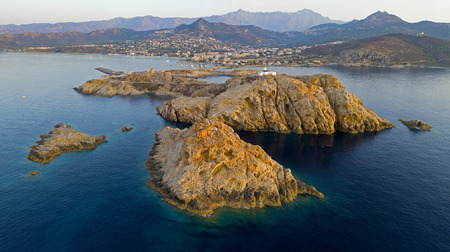 Aerial view of the Stone Lighthouse at sunset, Ile-Rousse, Red Island Corsica, Corsica, France Stock Photo
