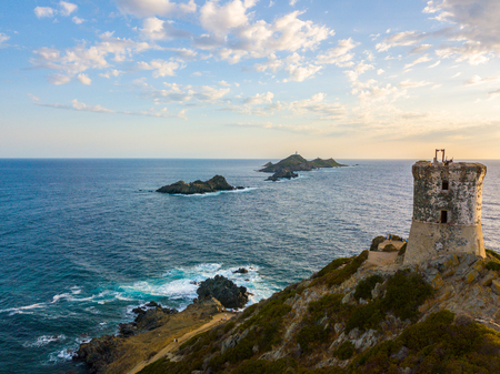 Aerial view of the Bloods Islands and the Parata Tower, the Genoese tower built in 1608, Corsica. France. Sunset over the sea on the dark red porphyry islands Stock Photo