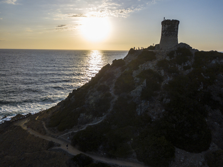 Aerial view of the Parata Tower from the sea, Genoese tower built in 1608, Corsica. France. Sunset over the sea in the Gulf of Ajaccio near the bloody islands Stock Photo