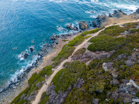 Aerial view of the panoramic path that leads to the promontory view to admire the bloody islands. Hiking trail. Corsica, France