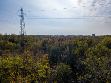 Aerial view of an electric trellis immersed in greenery, electricity, electric wires, Фото со стока