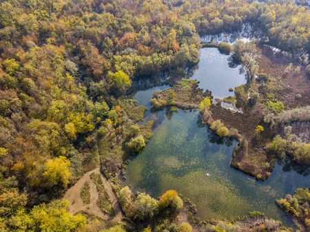 Nature and landscape: aerial view of a forest and lakes, autumn leaves, foliage, greenery and trees in a wilderness landscape Foto de archivo