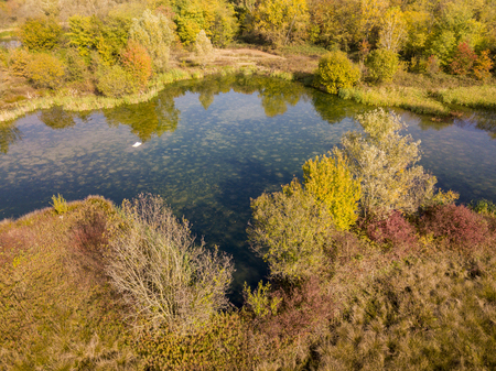 Nature and landscape: aerial view of a forest and lakes, autumn leaves, foliage, greenery and trees in a wilderness landscape Stock Photo