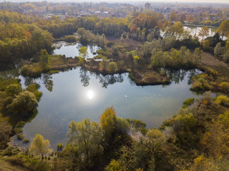 Nature and landscape: aerial view of a forest and lakes, autumn leaves, foliage, greenery and trees in a wilderness landscape 스톡 콘텐츠