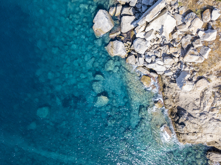 Aerial view of the rocks on the sea. Overview of the seabed seen from above, transparent water