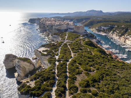 Aerial view of Bonifacio old town built on cliffs of white limestone, cliffs. Harbor. Corsica, France. Strait of Bonifacio separating Corsica from Sardinia Stock Photo