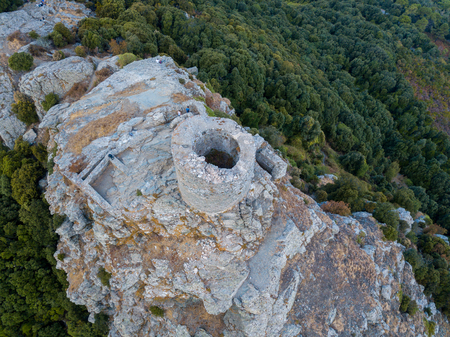 Aerial view of the Seneca Tower, Corsica, France, ancient Genoese tower of the 16th century in the heart of the Cape Corse, built as guard tower, historical monument since 1840 Stock Photo