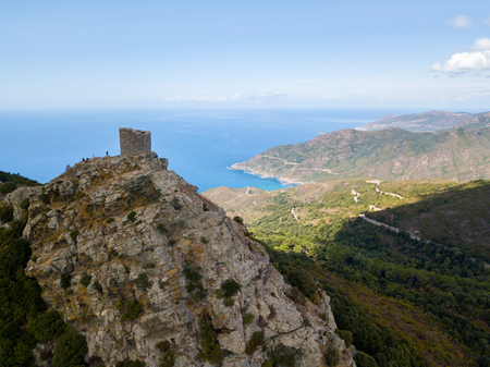 Aerial view of the Seneca Tower, Corsica, France, ancient Genoese tower of the 16th century in the heart of the Cape Corse, built as guard tower, historical monument since 1840 Imagens
