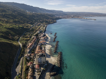 House with rocks on the sea. Pier of Pizzo Calabro, panoramic view from above. Calabrian coast of Southern Italy. Calabria, Italy