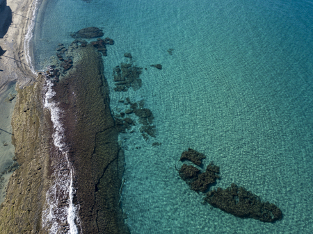 Aerial view of rocks on the sea. Seen from above, transparent water