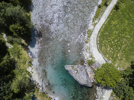 Aerial view of the giant rock called the Contessas Bidet in the Val di Mello, a green valley surrounded by granite mountains and woods. Sondrio. Lombardy. Italy Stock Photo