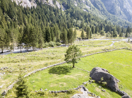 Mello Valley aerial view, Val di Mello, a valley surrounded by granite mountains and forest trees, renamed the little Italian Yosemite Valley. Italy
