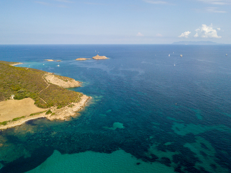 Aerial view of the islands of Finocchiarola, Mezzana, Land, Peninsula of Cap Corse, Corsica. Tyrrhenian Sea, Uninhabited Islands that are part of the municipality of Rogliano. France. Sailboats and boats moored in a bay on the Peninsula of Cap Corse