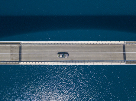 Aerial view of the island of Pag, Croatia, roads and Croatian coast. Cliff overlooking the sea. Car crossing the bridge seen from above