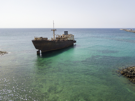Aerial view of a ship in the Atlantic ocean. Details of the ship seen closely. Wreck of the Greek cargo ship: Telamon; near Arrecife in Lanzarote, Canary Islands, Spain