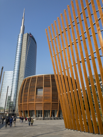 Unicredit tower, Unicredit Pavilion and Coima building seen from the pedestrian bridge at the end of Alvar Aalto square. 15/10/2018. Milan, Italy. Unicredit tower is Italy's tallest skyscraper building