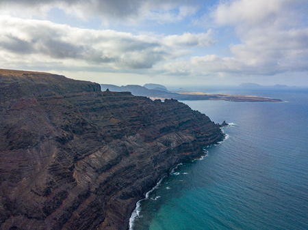 Aerial view of the mountainous coasts of the island of Lanzarote, Canary Islands, Spain. Africa. Reliefs overlooking the sea and dirt paths. Hiking trails Stock fotó
