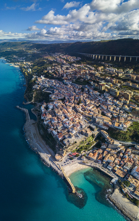 Aerial view of Pizzo Calabro, pier, castle, Calabria, tourism Italy. Pizzo Calabro by the sea. Houses on the rock. On the cliff stands the Aragonese castle Фото со стока
