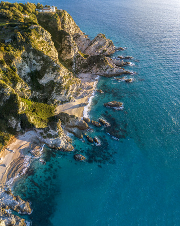Aerial view of Capo Vaticano, Calabria, Italy. Ricadi. Lighthouse. Coast of the Gods. Promontory of the Calabrian coast at sunset. Jagged coastline, coves beaches
