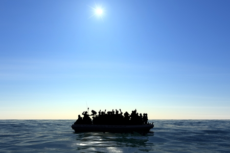 Refugees on a rubber boat in the middle of the sea that require help. Sea with people asking for help. Migrants crossing the sea Reklamní fotografie