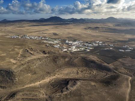 Aerial view of a desert landscape on the island of Lanzarote, Canary Islands, Spain. Mountains of the village of Soo and in the background Timanfaya. Reliefs and volcanoes on the horizon Reklamní fotografie