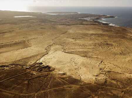 Aerial view of a desert landscape on the island of Lanzarote, Canary Islands, Spain.