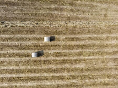 Nature and landscape: Aerial view of a field, plowed field, cultivation, green grass, countryside, farming, haystacks, hay bales