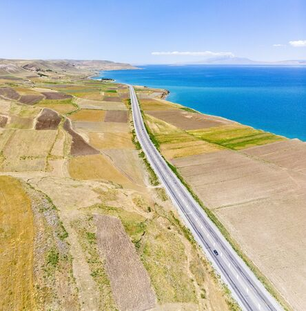 Aerial view of the lake. The largest lake in Turkey. Fields and cliffs overlooking the crystal clear waters. Roads along the lake