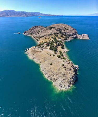 Aerial view of Akdamar Holy Cross Church, hidden monuments of Anatolia. Island of Akdamar on lake Van, eastern Turkey. Akdamar Church is remarkable for its exceptionally rich stone reliefs Stock Photo