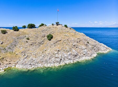 Aerial view of Akdamar island on lake Van, eastern Turkey. Turkey flag on the island