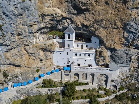 Aerial view of the monastery of Ostrog, Serbian Orthodox Church in Ostro? Ka Greda, Montenegro. Dedicated to Saint Basil of Ostrog 写真素材 - 132172343