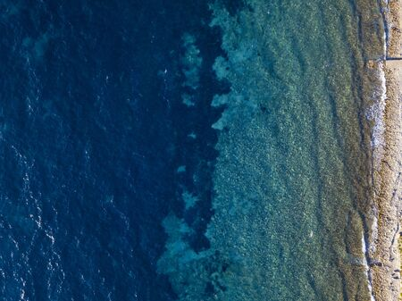 Aerial view of a seabed seen from above, sunset time, Adriatic sea. Buljarica beach. montenegro