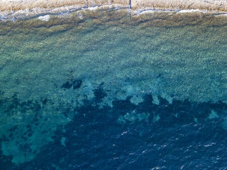 Aerial view of a seabed seen from above, sunset time, Adriatic sea. Buljarica beach, Montenegro Фото со стока