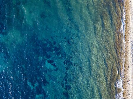 Aerial view of a seabed seen from above, sunset time, Adriatic sea. Buljarica beach, Montenegro