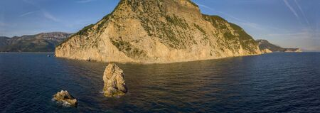 Aerial view of Buljarica headland, steep cliff on the coast lapped by crystal clear waters of the Adriatic sea. Petrovac, coastal town in Budva municipality. montenegro